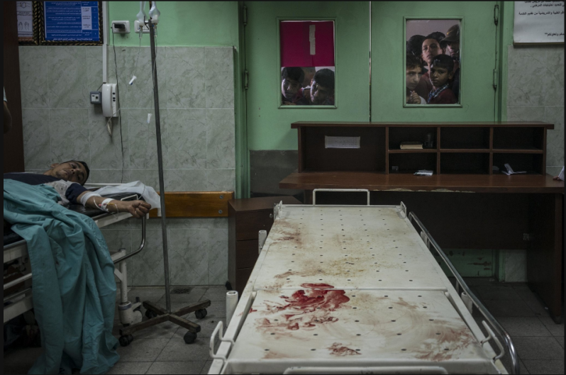 Beit Lahiya, Gaza Strip 07/24/2014 Relatives looked into a hospital's operating room at those injured in an Israeli airstrike nearby. Sergey Ponomarev for The New York Times
