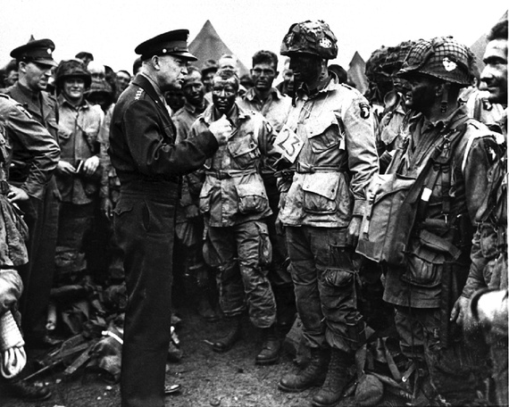 """Full-victory—nothing else"": General Dwight D. Eisenhower gives the order to paratroopers in England the night before they board planes to join the first assault in the D-Day invasion of Europe. (U.S. Army Signal Corps/AP)"