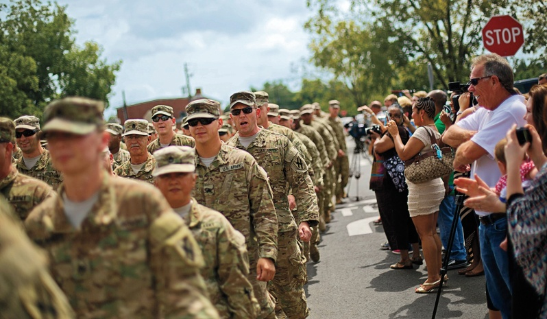 Always supportive of the troops: Crowds in Macon welcome back 200 members of the Georgia National Guard's 48th Infantry Brigade Combat Team returning from Afghanistan, September 2014. (David Goldman/AP)