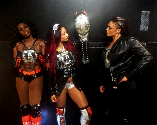 Sasha Banks is the one in the middle holding the NXT Women's Championship.